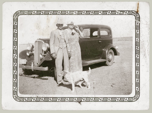 Couple and dog with Car