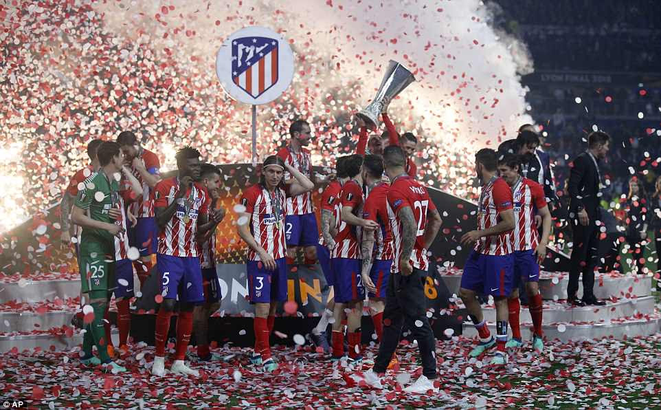 Atletico players celebrate with the trophy amid jubilant scenes after a deserved win over Marseille in the final