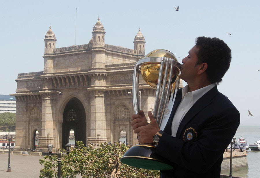 Sachin Tendulkar kisses the World Cup in front of the Gateway of India