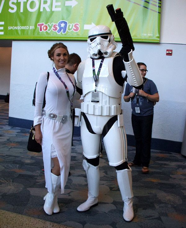 Fans dressed as Princess Leia and a Stormtrooper strike a pose at the Star Wars Celebration in Anaheim, California...on April 16, 2015.