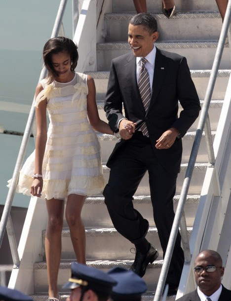 U.S. President Obama and his daughter Malia exit Air Force One upon arrival in Santiago
