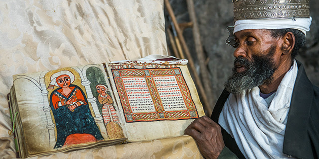 An Orthodox priest at Nakuto Lab Rock Church, outside Lalibela, Ethiopia. About three-quarters of Orthodox Ethiopians say they attend church every week. (Eric Lafforgue/Art in All of Us/Corbis via Getty Images)