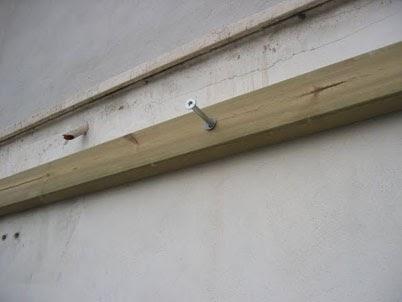 Fissaggio travi in legno a muro