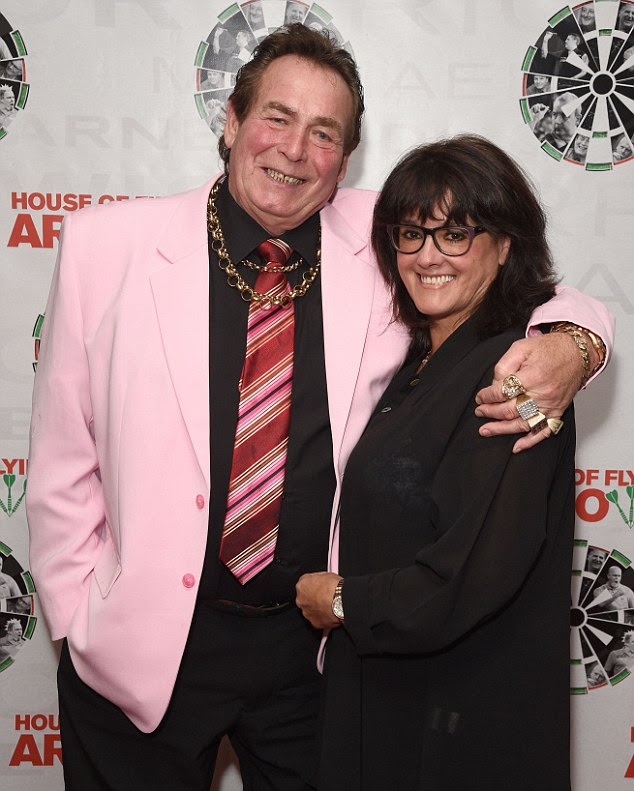 Hugs:Bobby George and Marie George attend the House of Flying Arrows exclusive screening