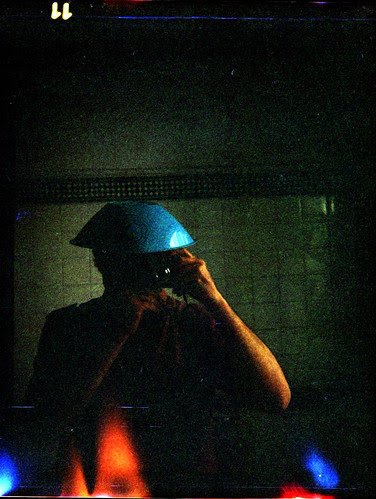 reflected self-portrait with Bencini Comet-S camera and Mallorcan hat by pho-Tony