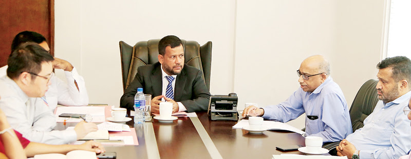 Minister of Industry and Commerce Rishad Bathiudeen (centre) meets the Second Secretary of Chinese Embassy in Colombo Mr Ran Xiong (left) and Secretary of Sri Lanka Canned Fish Association Chathura Wicremanayake (right) on 10 July in Colombo.