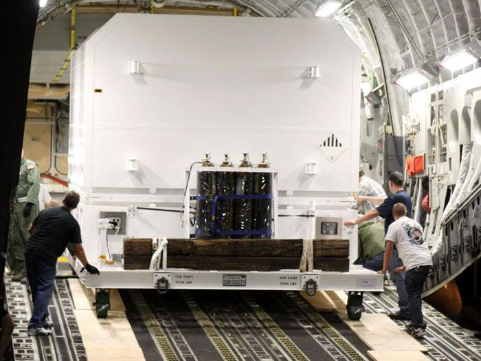 A crate carrying the CURIOSITY Mars Rover is unloaded from the C-17 aircraft that flew it from California to Kennedy Space Center in Florida, on June 22, 2011.
