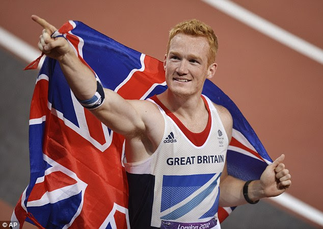 Greg Rutherford celebrates winning gold in the men's long jump final during the athletics in the Olympic Stadium at London 2012