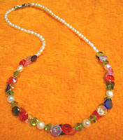 stringed piece of necklace of crystal and pearl
