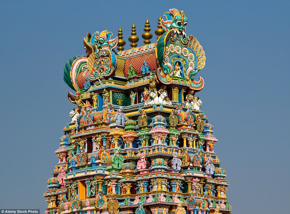 Rising up to 170 feet in the air, the 12 adorned towers of the Meenakshi Temple are covered in an impressive display of around 33,000 sculptures - all accentuated with a riot of bright colours