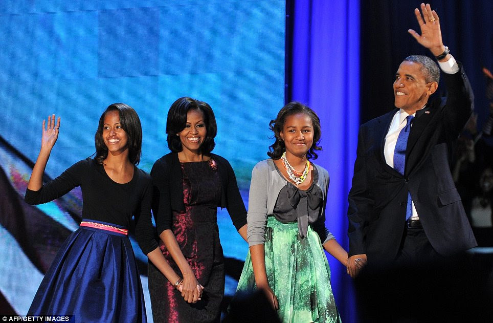 Family: The delighted President was joined by his wife Michelle and their daughters Sasha and Malia