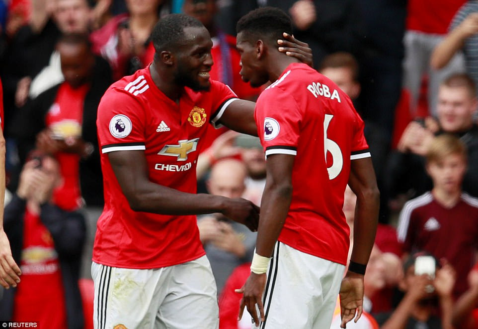 Lukaku celebrates with his new team-mate and close friend Pogba after the Frenchman adds a fourth and final goal