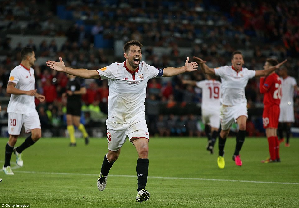 Sevilla captain Coke wheels away after scoring the first of his two goals in the 3-1 victory over Liverpool