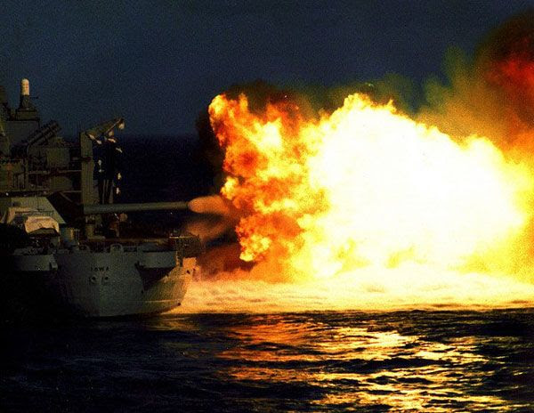 The USS Iowa fires her 16-inch guns during a naval exercise in the 1980s.