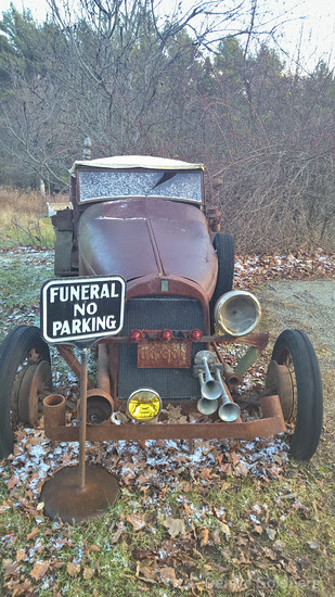 antique car, hiding behind a funeral sign