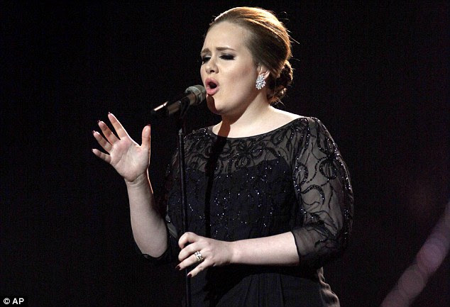 Rainha da noite: Adele recebeu um total de seis indicações em algumas das categorias mais prestigiadas, retratado aqui no início deste ano no Brit Awards em Londres