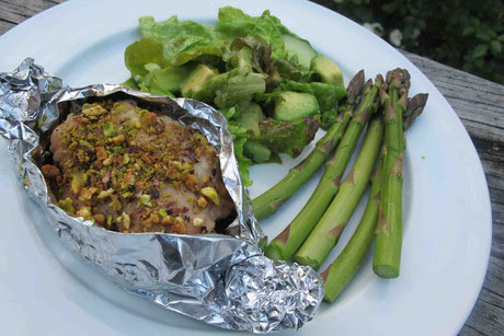 Chicken in tinfoil boats, served with new season asparagus