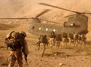Soldiers board a Chinook helicopter.