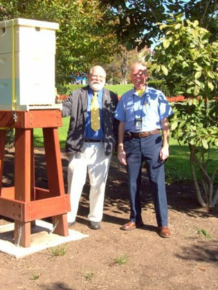 Bee Culture Editor Kim Flottum, left, with White House bee keeper Charlie Brandts beside the South Lawn hive.