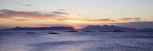 Eigg and Rhum Sunset from Camusdarach by Christopher Swan