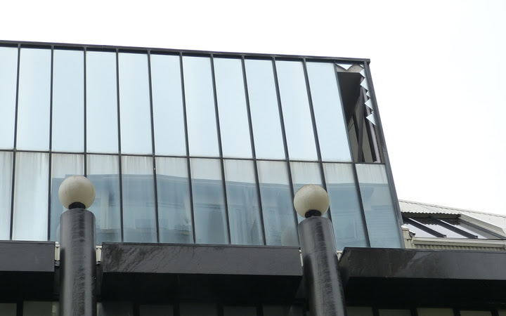 A damaged window can be seen at Whitireia Performing Arts Centre.