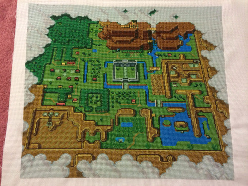 Redditor tibtibs spent between 400-500 hours over the course of nine months working on this awesome cross-stitched map for The Legend of Zelda: A Link to the Past. She worked from a free pattern that was posted on the Sprite Stitch Board. This magnificent work of craftiness was made as a gift for tibtibs' gamer boyfriend, who must be pretty awesome himself considering all of the eye strain and cramped fingers she endured while working on this geektastic project. [via Nerd Approved]