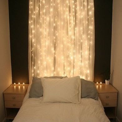 Want to create a tranquil atmosphere conducive to rest? Hang string lights over a dark-painted wall, with sheer curtains to soften and diffuse the effect. This headboard definitely lights up the night.