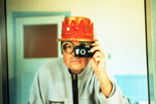 reflected self portrait with Olympus mju II camera and compound hat by pho-Tony