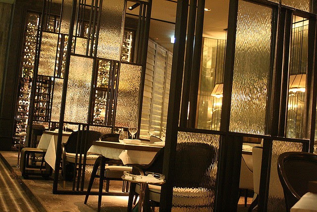 The main dining area is an elegant setting of glass, metal and art deco motifs