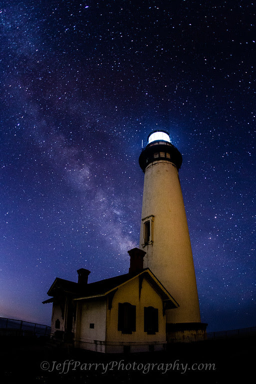 Pigeon Point Lighthouse shines below the Milkey Way Galaxy