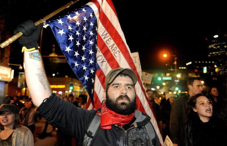 Des rassemblements ont notamment été signalés à New York, Chicago, Denver (notre photo) ou Dallas.