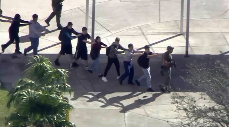Students from Marjory Stoneman Douglas High School in Parkland evacuate the building during the mass shooting on Wednesday. (Photo: AP)