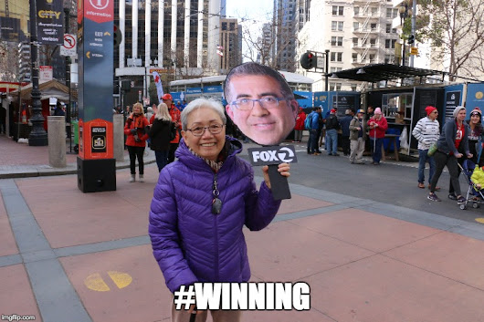 Hey, Here's a Picture of a Woman on Market Street With a Cutout of Sal Castaneda
