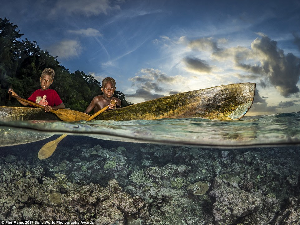 Pier Mane captured this indigenous tribe of the Solomon islands. He said of the image: 'It seems kids learn to paddle before they walk'