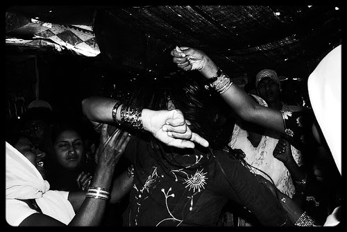 Sprinkling Holy Water On A Possessed Woman At Haji Malang by firoze shakir photographerno1