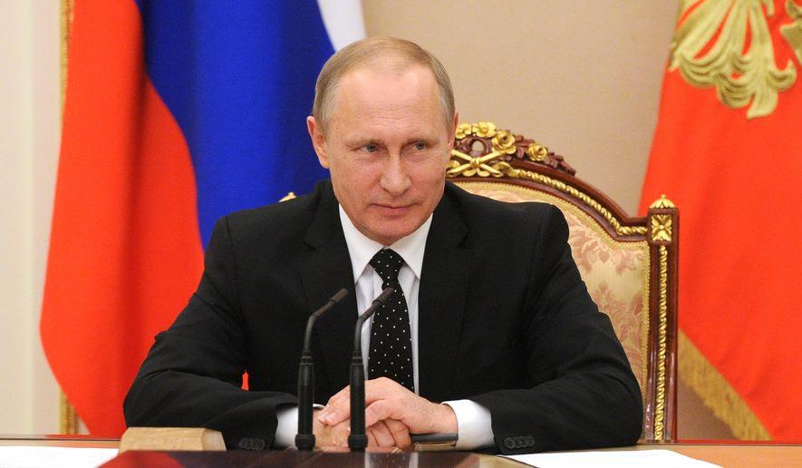 Russian President Vladimir Putin heads the Security Council meeting in the Kremlin, in Moscow, Russia, Tuesday, July 26, 2016. (Mikhail Klimentyev/Sputnik, Kremlin Pool Photo via AP)
