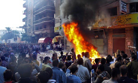 Protesters storm an office of Egyptian President Mohammed Morsi's Muslim Brotherhood Freedom and Justice party and set fires in the Mediterranean port city of Alexandria, Egypt, Friday, Nov. 23, 2012. by Pan-African News Wire File Photos