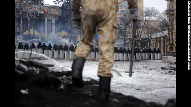 A protester stands on top of barricades in Ukraine's capital of Kiev on Tuesday, January 28. Long-running demonstrations escalated into violent confrontations this month, with police and protesters fighting in Kiev's icy streets.
