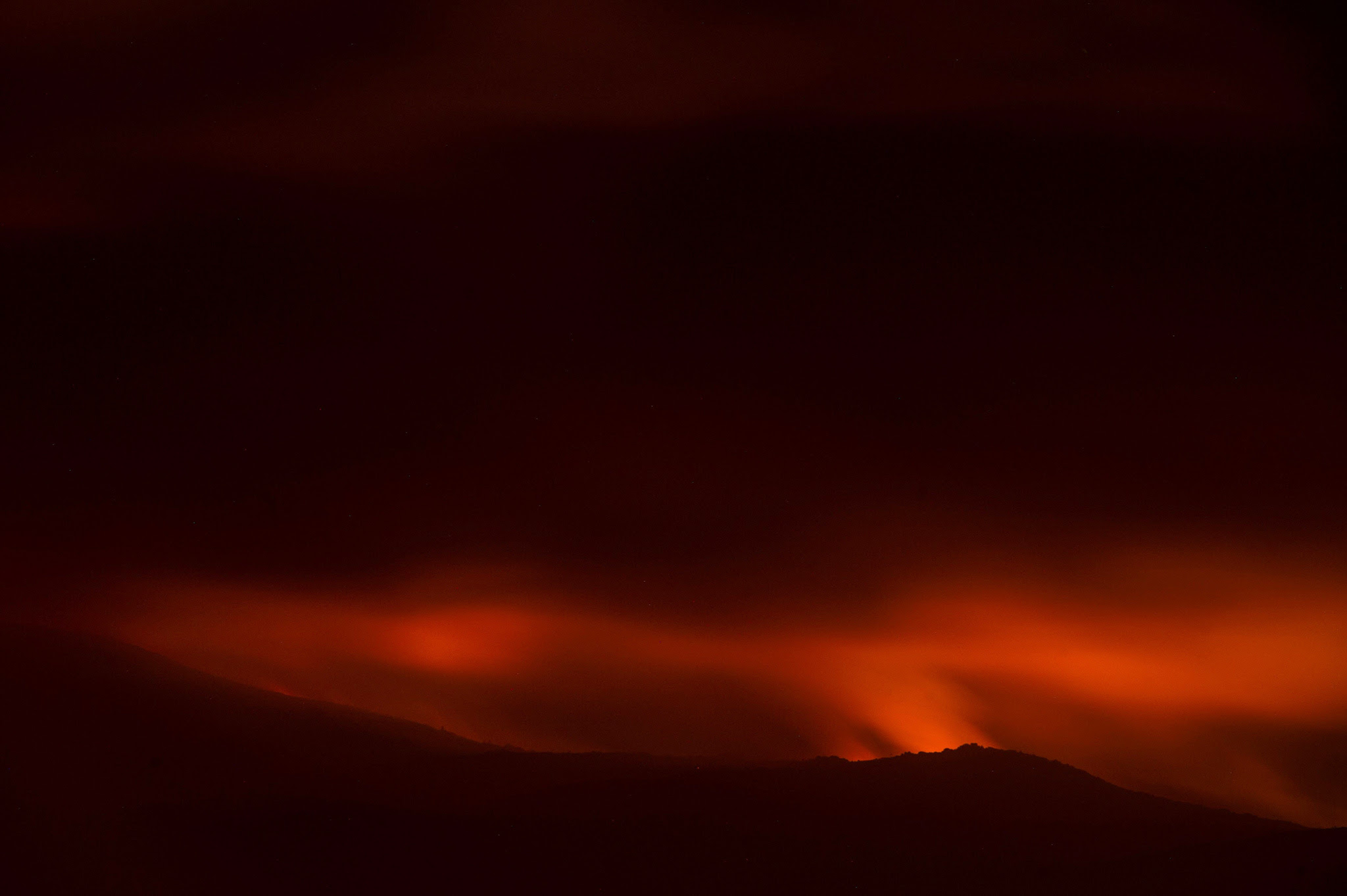 Light from a forest fire colours the sky red near the village of Entrimo, northwestern Spain