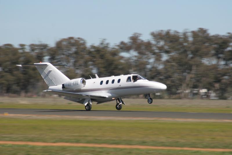 Small jet plane landing