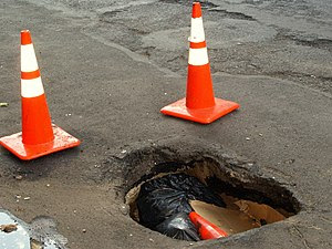 A large pot hole on Second Avenue in the East ...