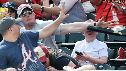 Phew! Fan Saves Boy From Being Hit By A Flying Baseball Bat
