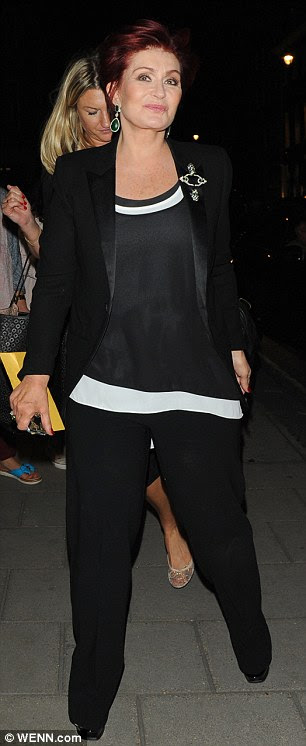 Glamourous: Sharn Osbourne, returned to The Claridge's hotel after a night out in London on Wednesday dressed in a sophisticated black ensemble with jewelled drop earrings