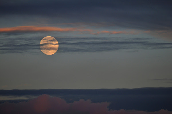 nearly full moon rising near Kenosha Pass