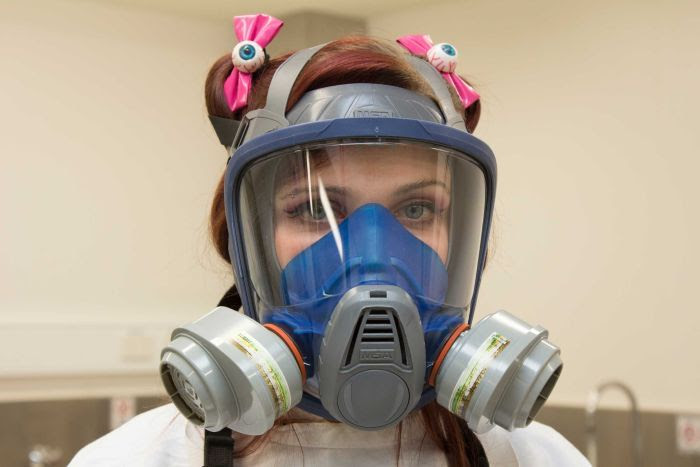 A close up of Hannah Lewis wearing protective breathing apparatus.