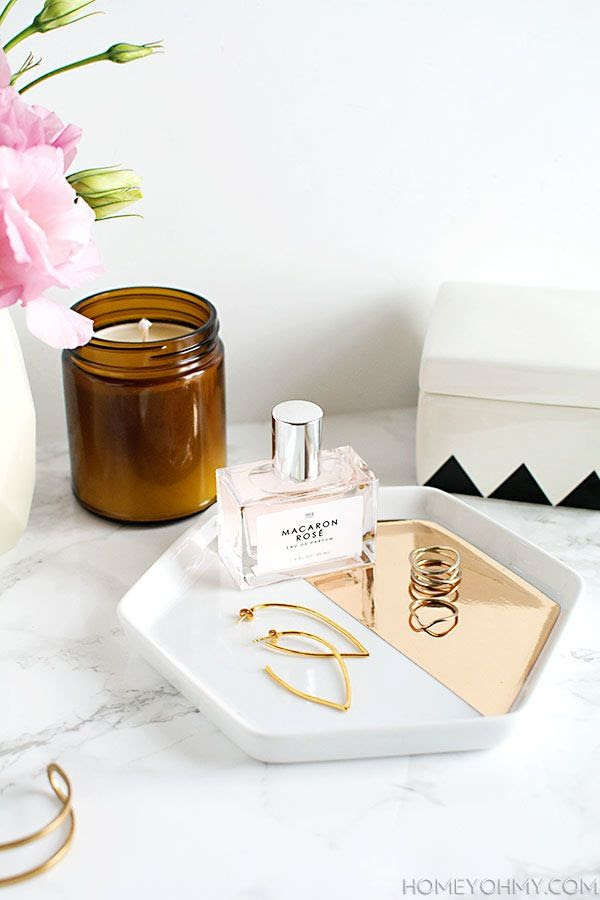 Le Fashion Blog DIY Mirrored Gold Jewelry Dish Hexagon Plate Marble Counter Rose Perfume Candle Gold Spiral Rings Via Homey Oh My
