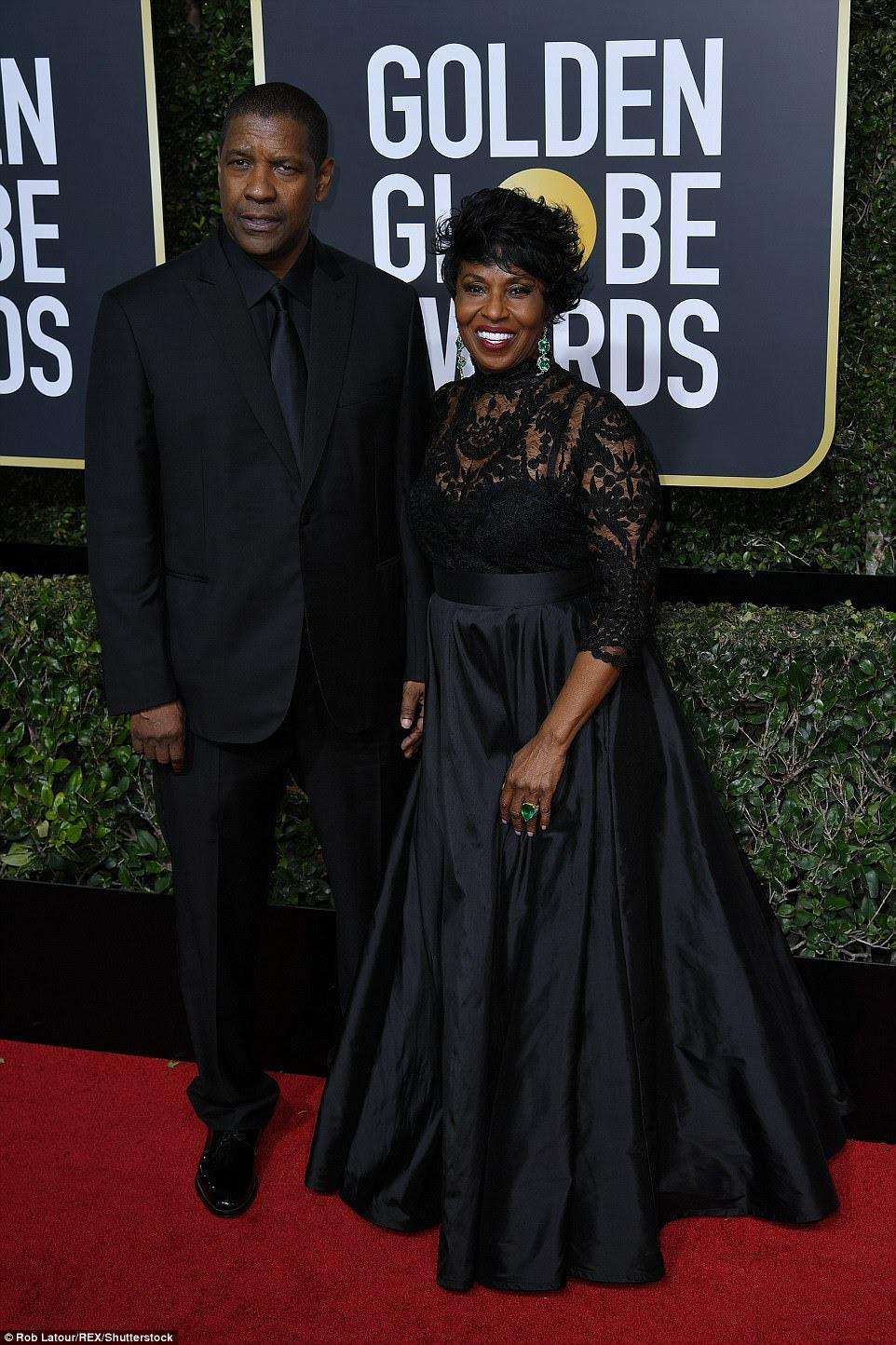Tendo uma explosão: Denzel Washington e sua esposa Pauletta ficaram perto do tapete vermelho após a chegada