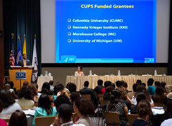 Julio Dicent-Taillepierre, providing students with background on the CDC Undergraduate Public Health Scholars Program (CUPS). Also pictured: Sam Gerber, CUPS Project Officer. Photo Credit: James Gathany, CDC.