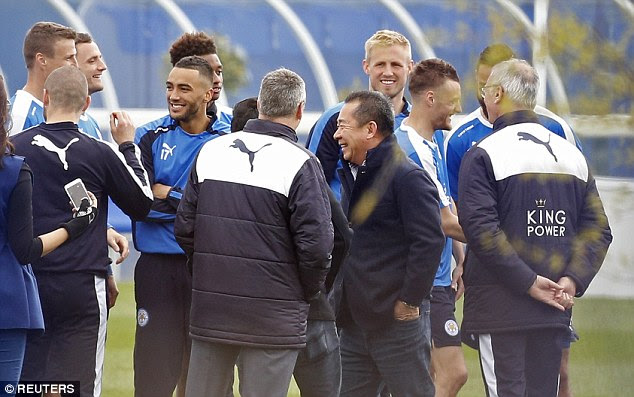 Ranieri (right) and owner Khun Vichai Srivaddhanaprabha (centre) celebrate with players during training today