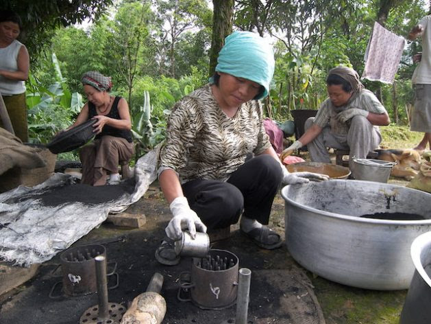 Instead of cutting forests to make charcoal for household energy, these Chinese women use bamboo which will grow back. Photo Courtesy of INBAR